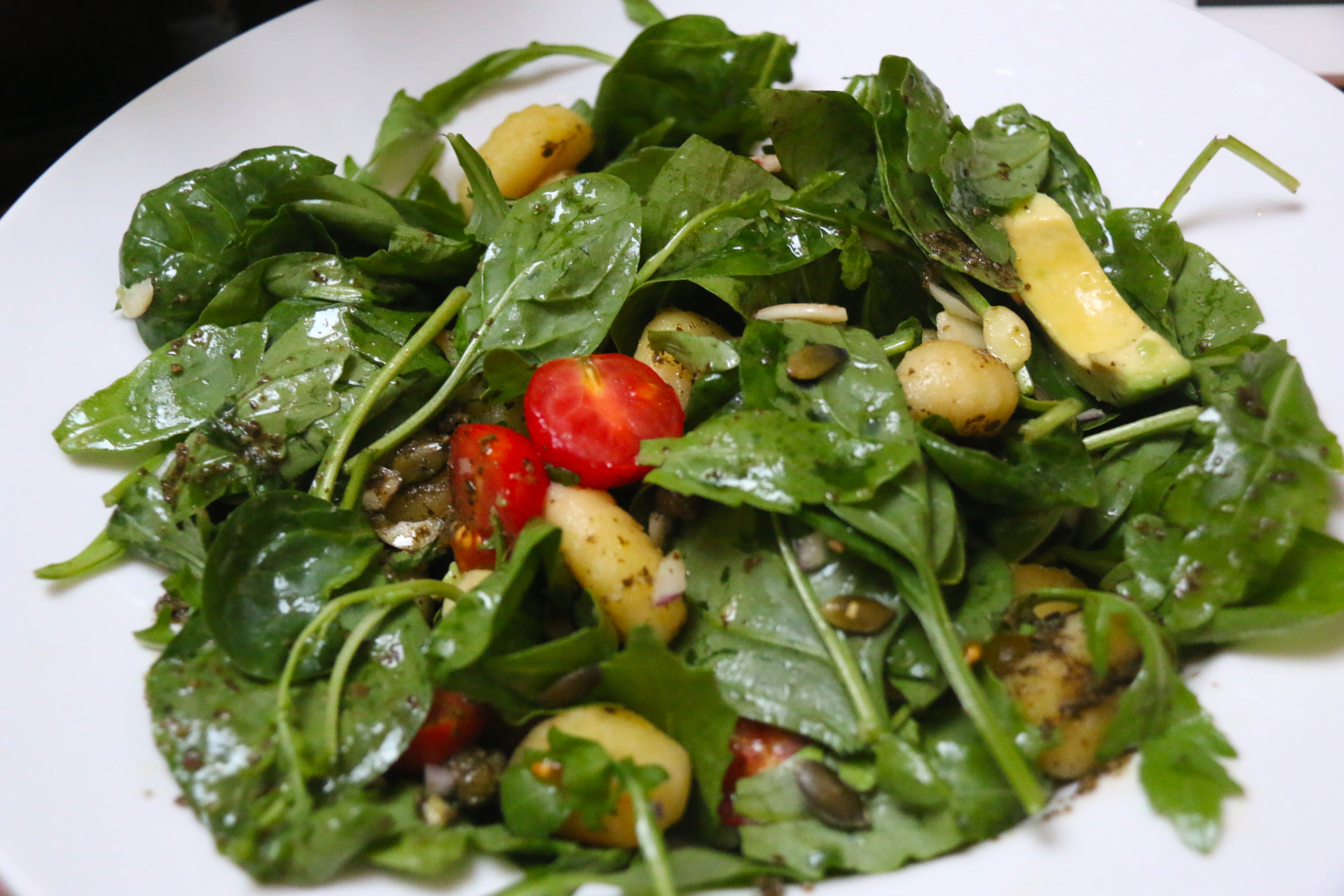 Spinach and rocket salad with oven-roasted tomatoes, avocado, capers ...